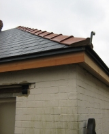 Ridge tiles and cedar trim on.