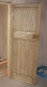 Original 1930s internal doors stripped back to the wood.